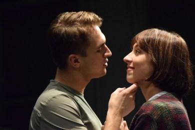 Jacob Burns cradles Logan Rae's face in rehearsal.