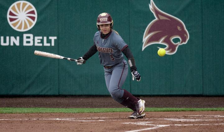 Bailee Carter looks after the ball as she begins to run. She is throwing her bat.