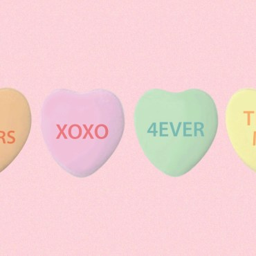 The image features a bubblegum pink background with four heart-shaped candies laid out horizontally in a straight line.