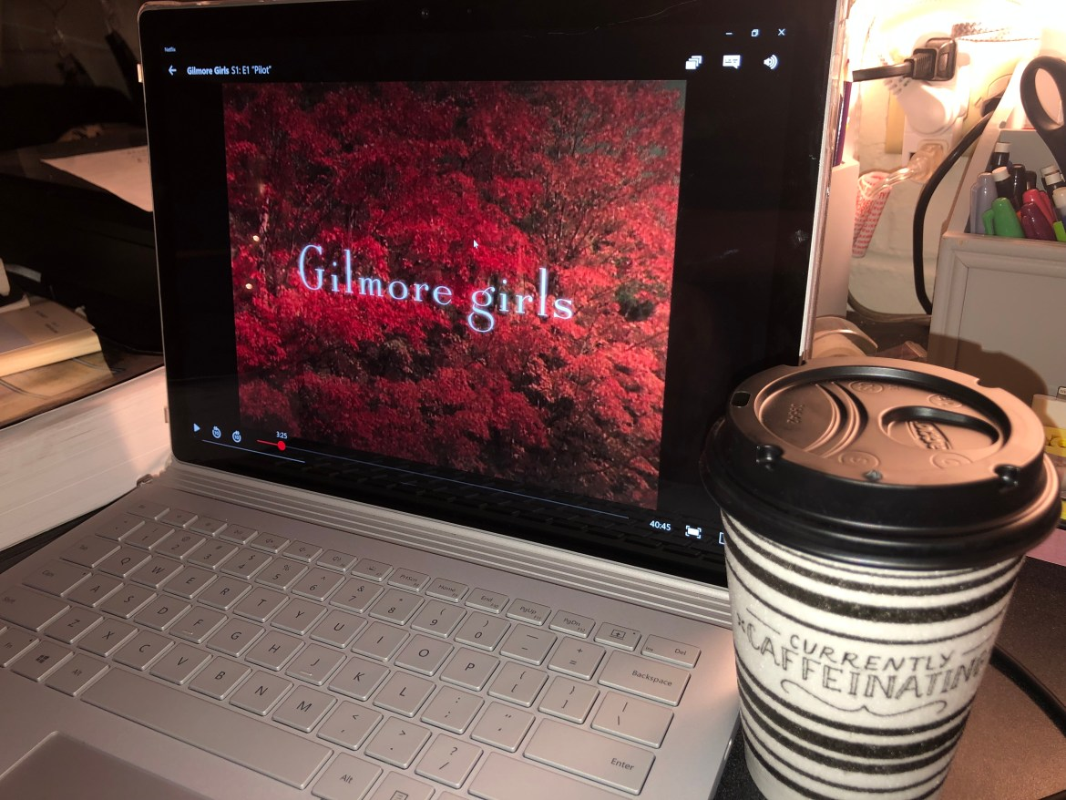 Woodsy background with Gilmore Girls title.