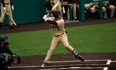 Player in batters box about to swing.
