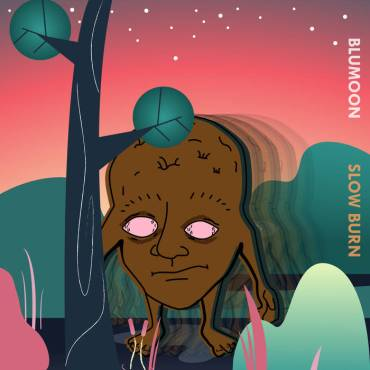 The album cover appears to be a man who is only a head in a forest with pink eyes