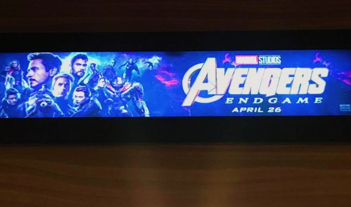 A strip poster for Avengers: Endgame over the theatre door.