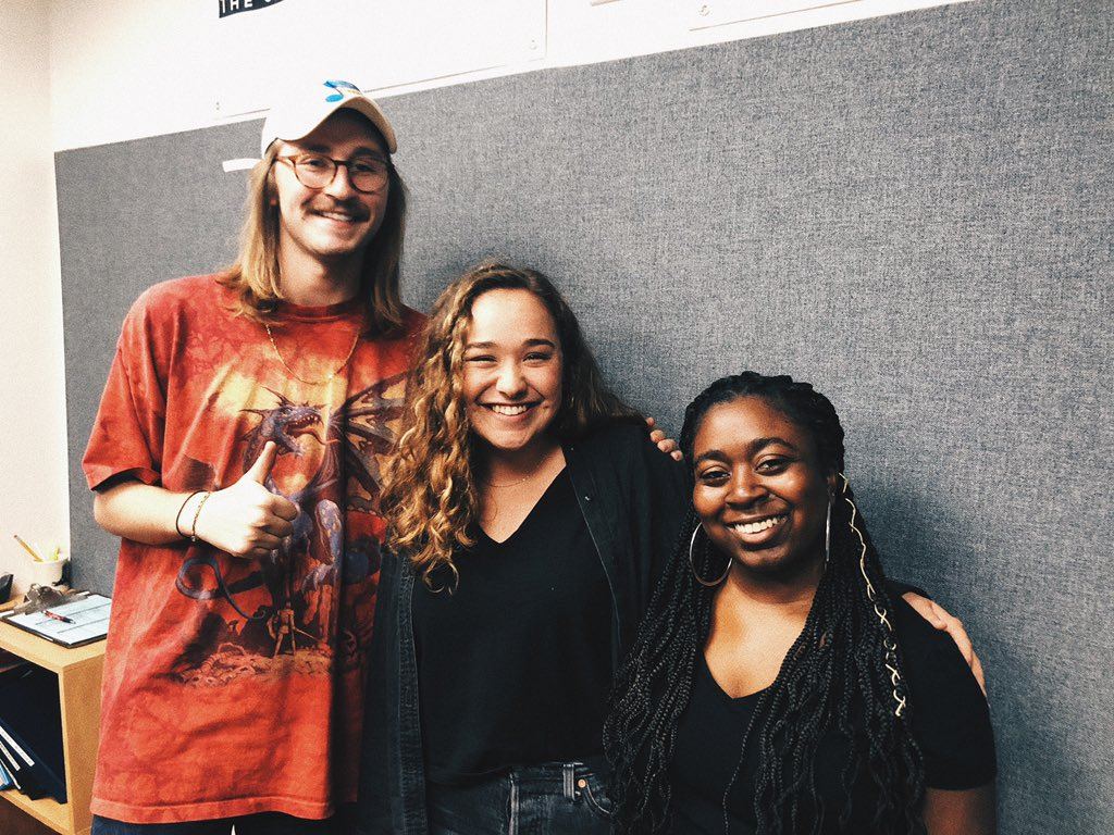 Two girls and one guy pose together in KTSW Studio.