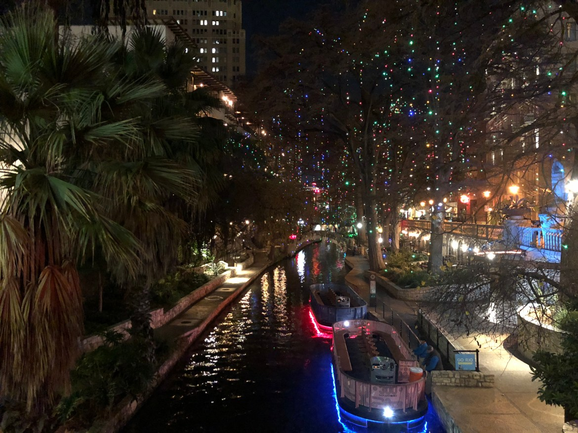 a view of the San Antonio Riverwalk during the holiday season .