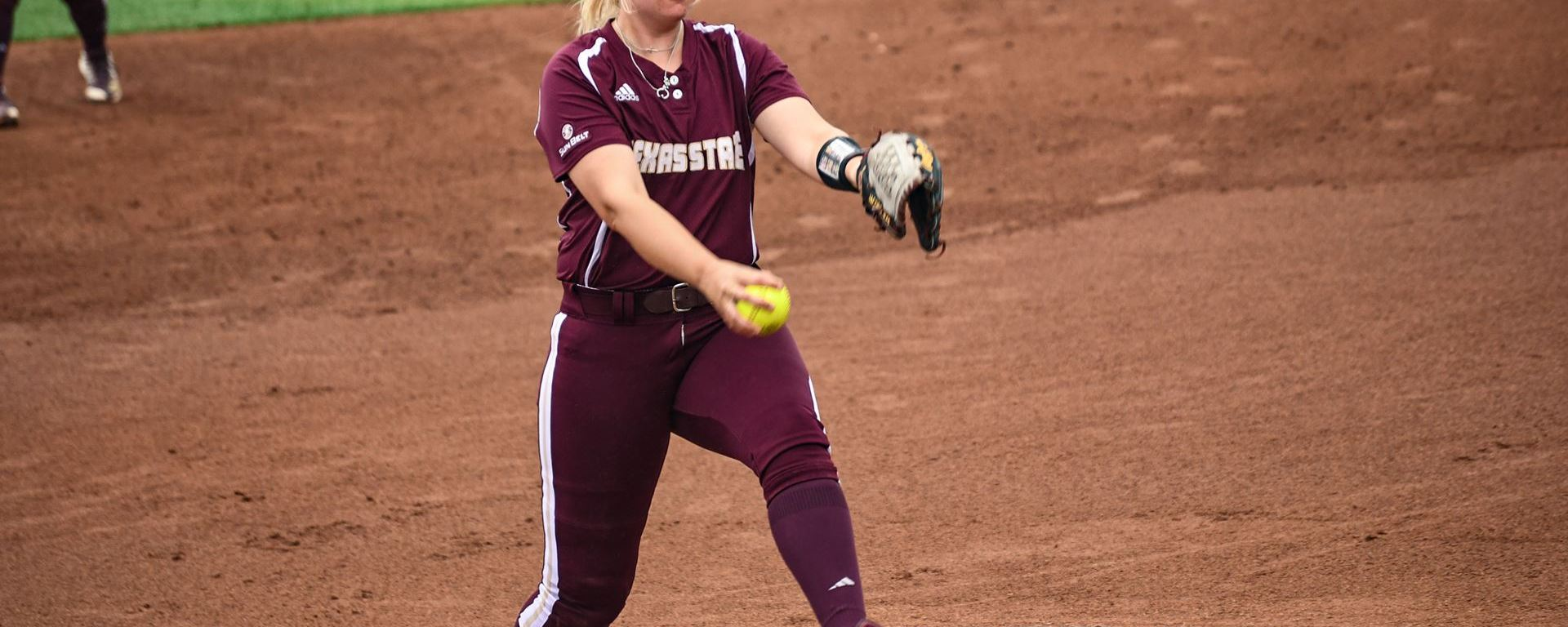 Senior Pitcher Krista Jacobs winds up for the pitch against the Panthers.