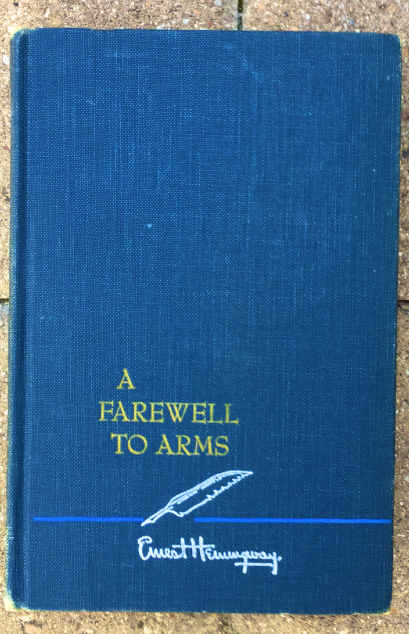"""A copy of """"A Farewell to Arms"""" cover. The cover is completely blue and appears to look like a first edition."""