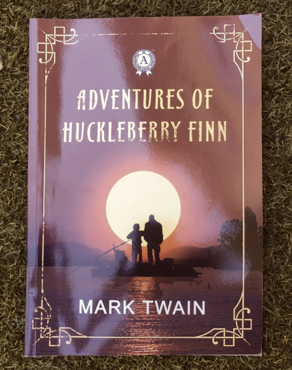 """Image of """"Adventures of Huckleberry Finn"""" book cover. Edited to have brown hues."""