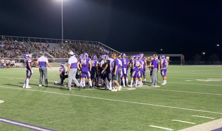 The rattlers are huddled up with their coaches on the field as they are preparing to play in overtime against east central high school.