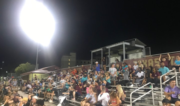 The Bobcat Soccer Complex stands filled with people here in support of Bobcat soccer. Some are wearing teal in support of ovarian cancer awareness.