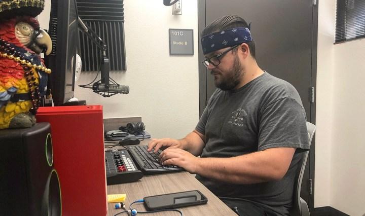 Jon-Paul Kasper is editing syndicated programs for KTSW in the studio.
