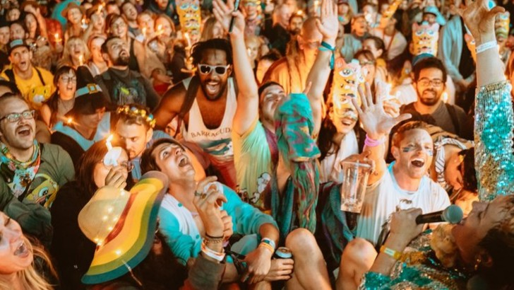 An up close shot of a crowd of people during a festival set