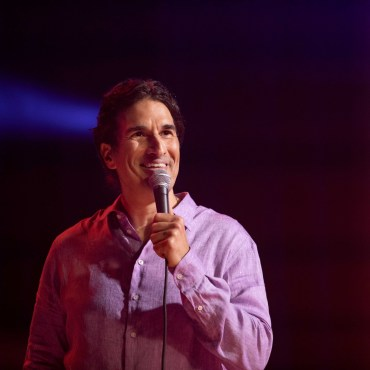 Gary Gulman performing stand up comedy.