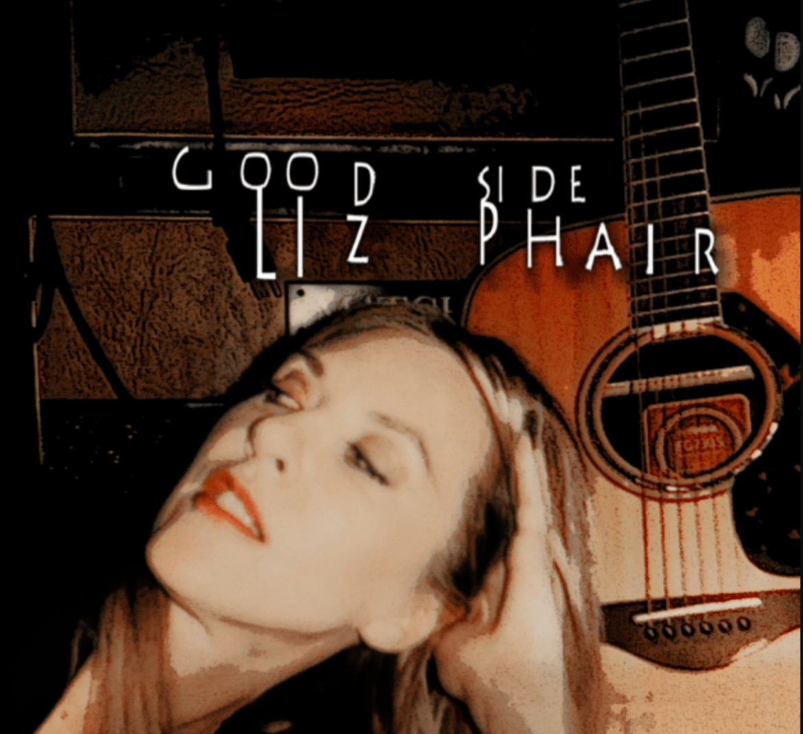 A caucasian female looking to her left side and showing the right side of her face with a guitar next to her.