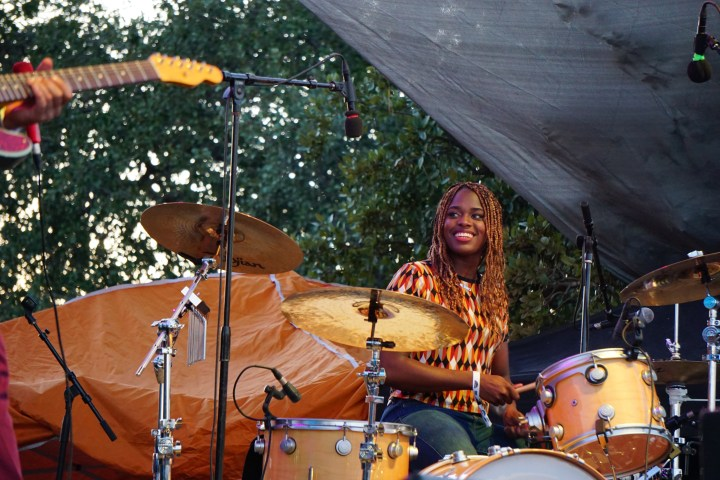 """Tikyra Jackson smiling big while drumming to the song """"What Did I Do?"""""""