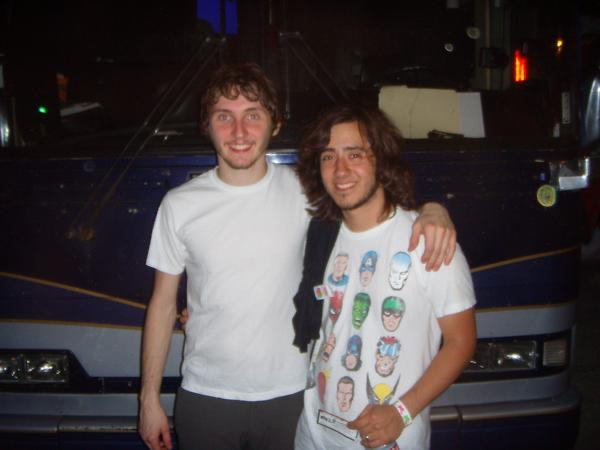 A fan meeting Kenny Vasoli of the starting line in front of the band's tour bus.