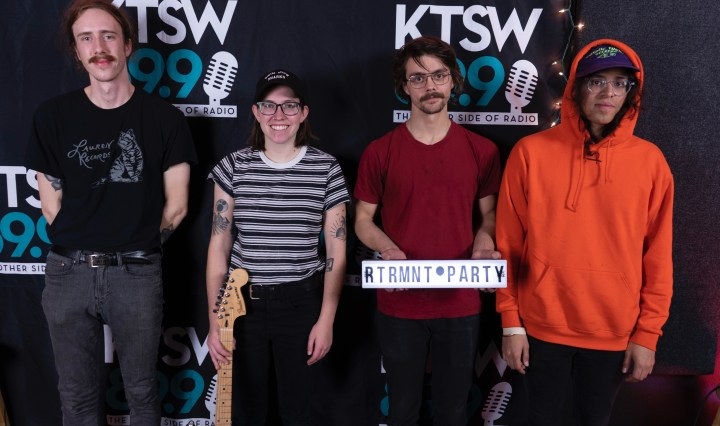 Retirement Party standing in front of a KTSW banner, with members (from left to right) James Ringness, Avery Springer, and Eddy Rodriguez.