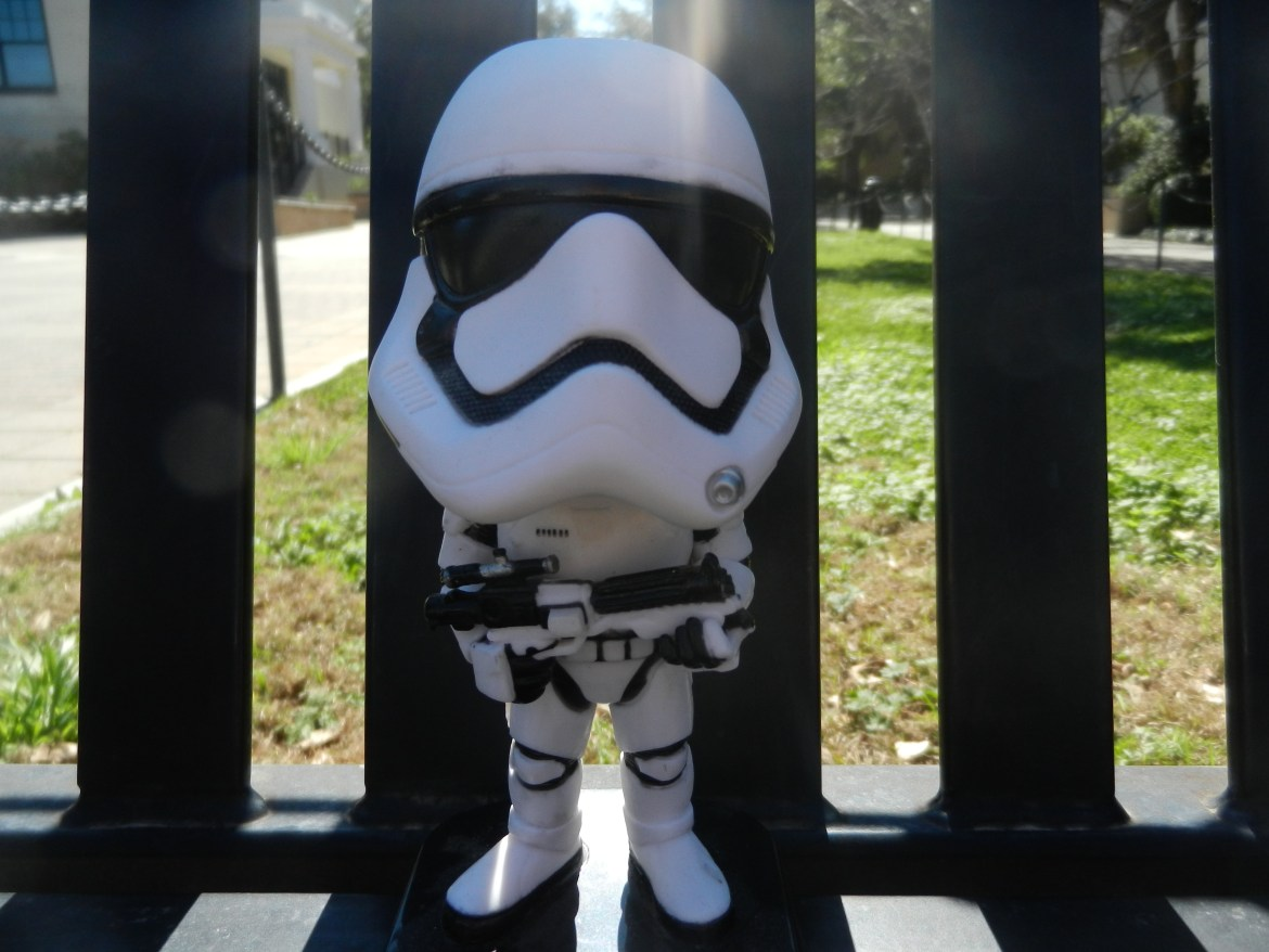 A bobble head of a Stormtrooper leans against the bench.