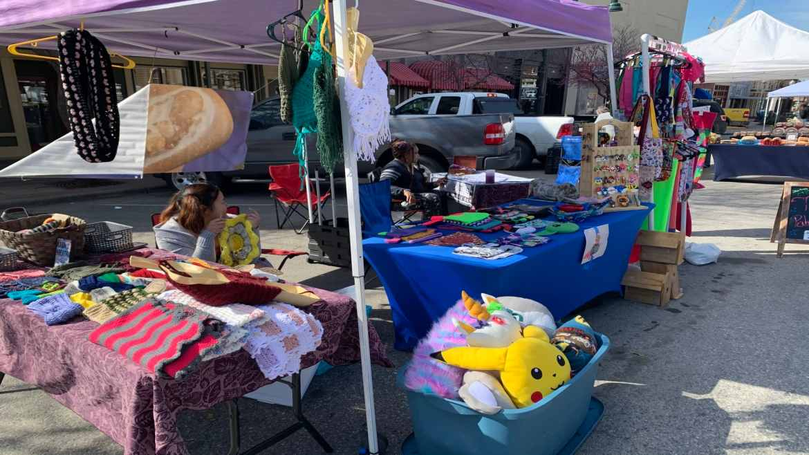 a picture of a stall selling clothes at the farmers' market