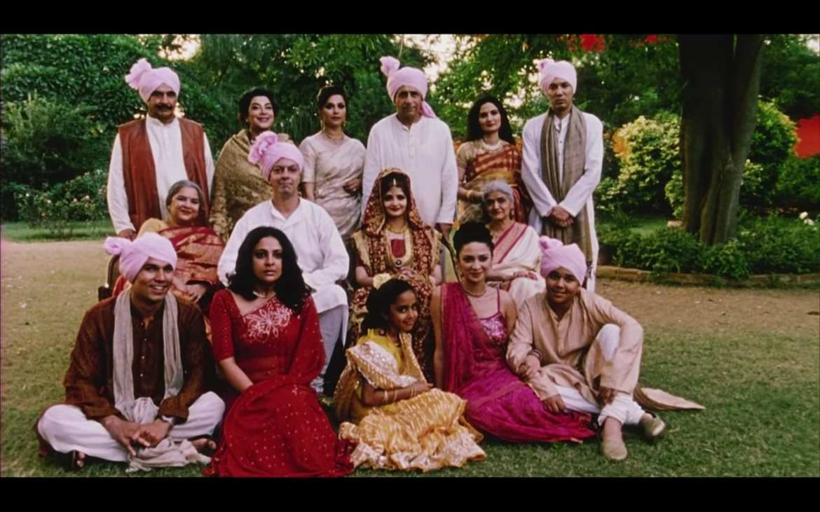 screenshot from Monsoon Wedding depicting the family of the film posing for a picture