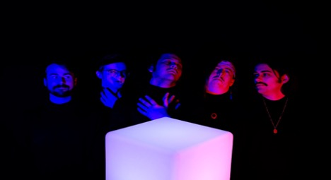 Photo of band Names listed left to right: John McIntyre, Quinn Decker, Travis Roper, Johne Bowers, Bryce Brown