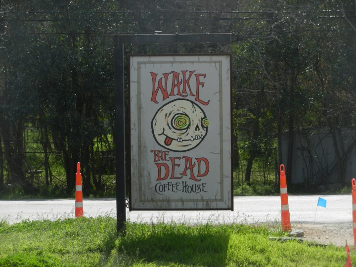 A Wake the Dead sign attracts potential customers.