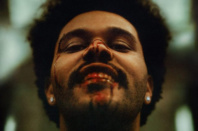 The album cover shows The Weeknd smiling with a bloody face and tilting his head backward