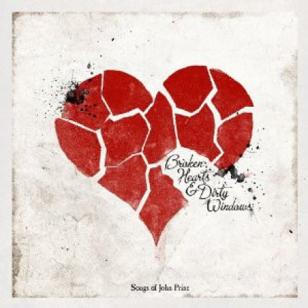 """Several small red pieces form to make a heart atop a grey background. The album title is located on the heart, with the words """"Songs of John Prine"""" located in the bottom center of the image."""