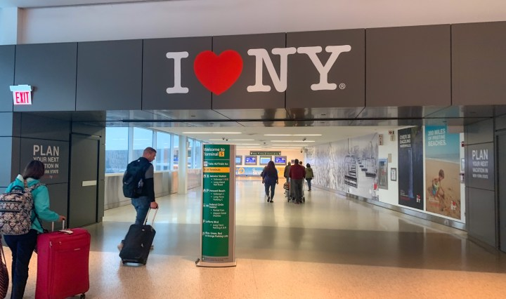 wall art with the words New York written in white letters on a black background with a red heart