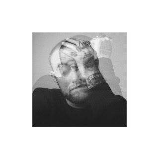 Solid white background with grey square in the middle. Within the grey square is a black and white photo of Mac Miller from the chest up. Miller is wearing a black sweater and has a tattooed hand covering one of his eyes while the other eye is shut. A slightly transparent photo is layered on top of the original photo. The transparent photo is almost identical to the original, except Miller's uncovered eye is open, and looking directly into the lens. The layered photos give the image an action effect.