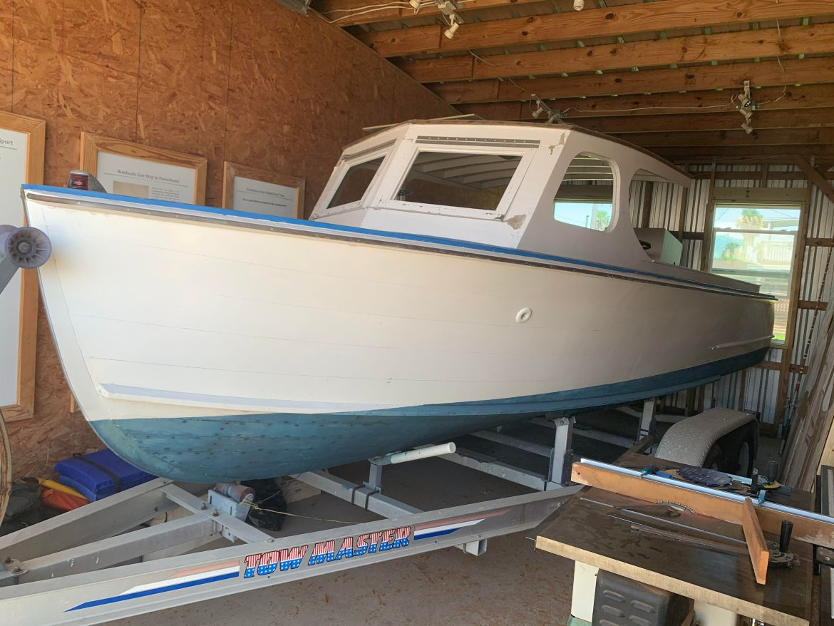Photo of a tarpon motor boat located in a garage at Farley's Boat Works.