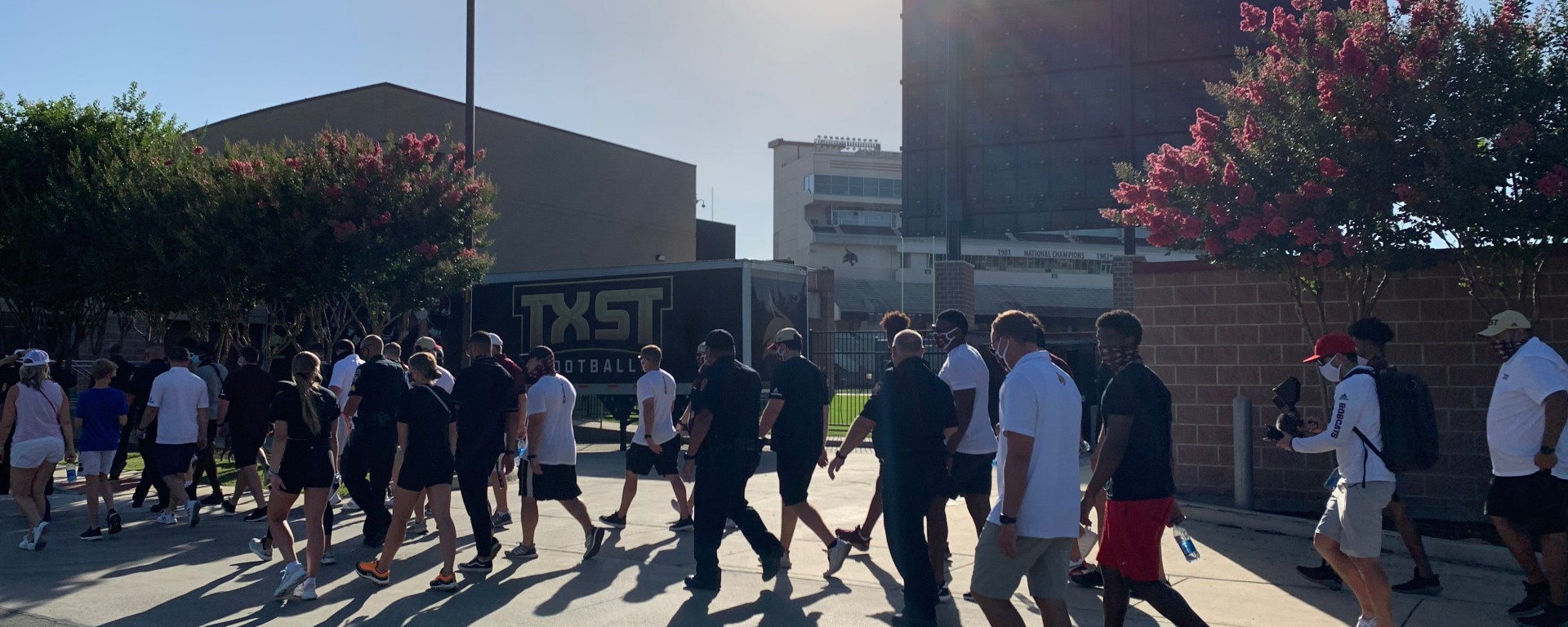 A group out of hundreds, including members of Texas State athletics such as head coach Jake Spavital, pass by Bobcat Stadium during the 2020 Unity March