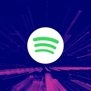 Green and white round Spotify logo on top of violet and pink beams of light