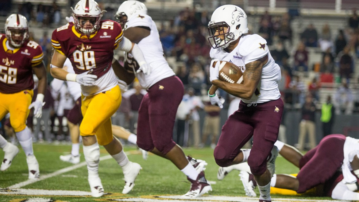 Texas State running back gliding through the ULM defense in a home game for the Bobcats against the Warhawks last season.