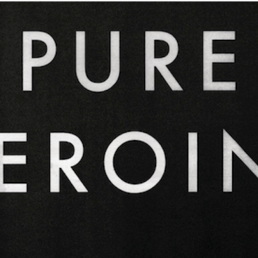 """The cover features a simple solid black background with """"PURE HEROINE"""" in big, white text."""
