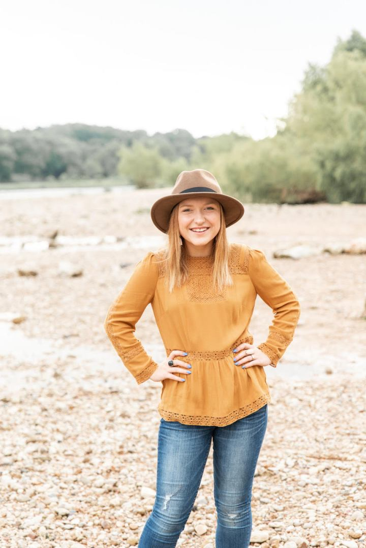 Image of Paige Procknow, Chief Marketing Officer at Austin Angels in the outdoor smiling.