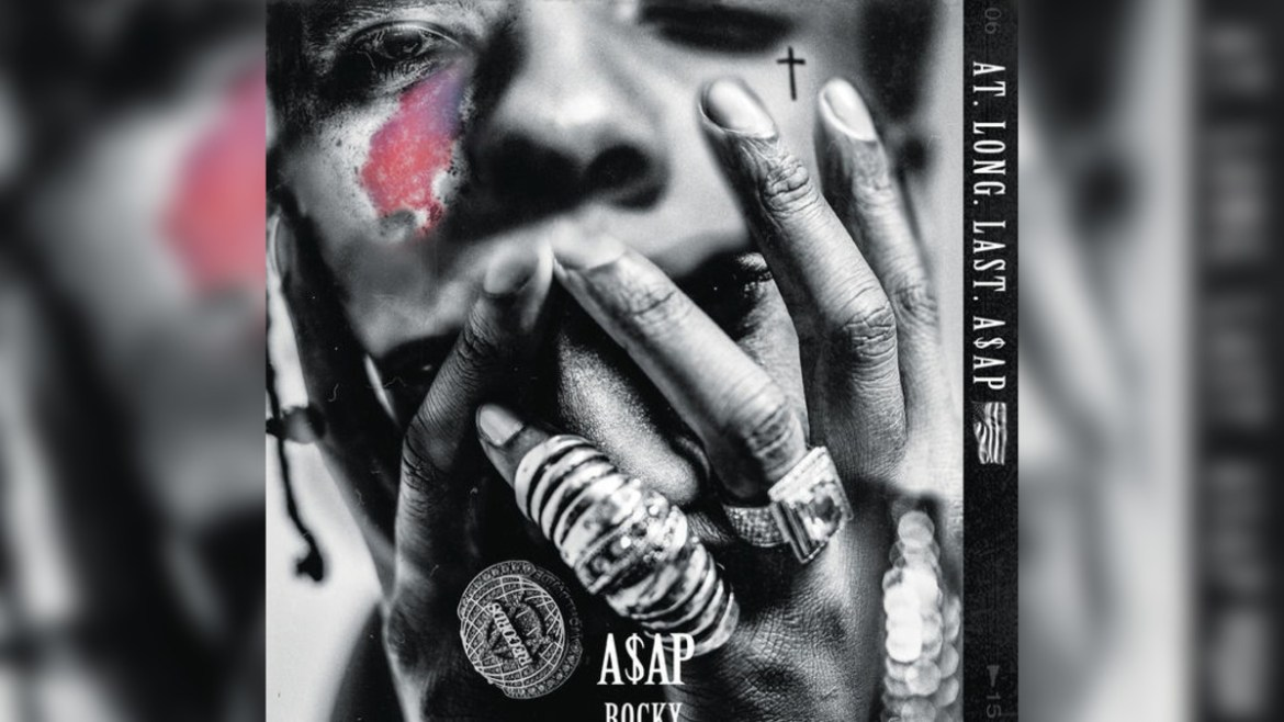 Up close picture of A$AP Rocky with his hands covering his mouth.