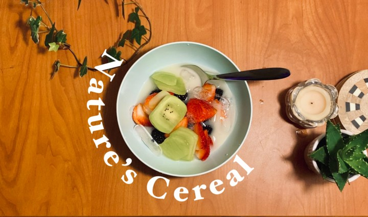 """Photo of strawberries, blackberries, kiwi and coconut water in a bowl with the words """"nature's cereal"""" around it"""