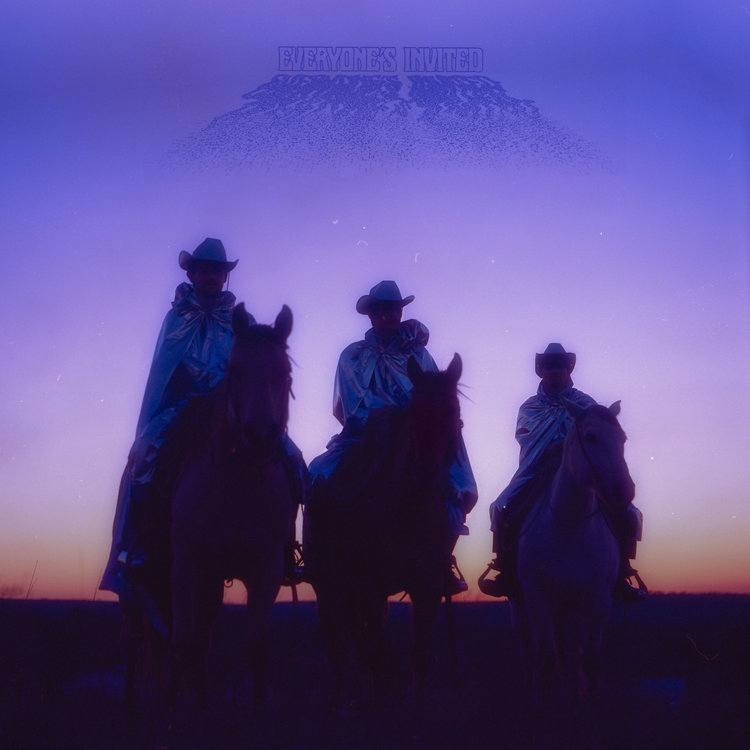The album cover is three men on horses dressed in a silver hooded trench coat and cowboy hats with a purple and pink sunset in the background.