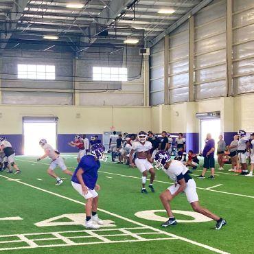 The San Marcos High School Football team practicing at their indoor stadium