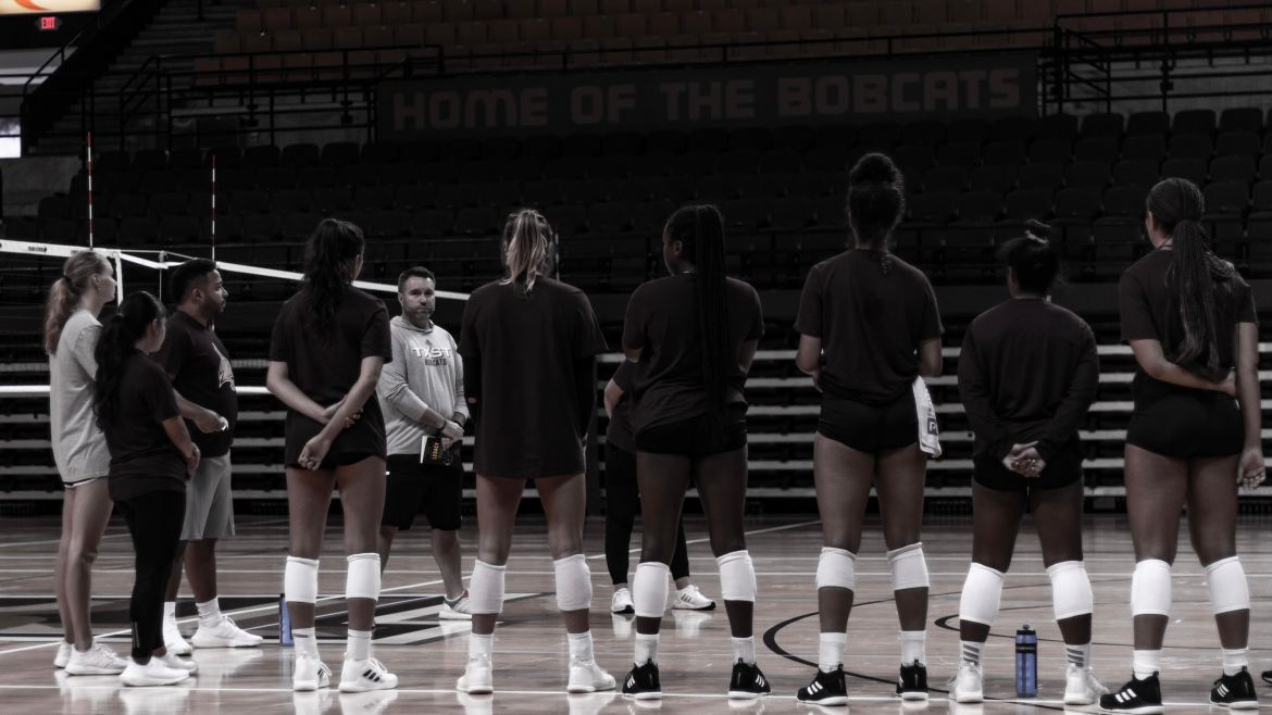 Texas State Volleyball Team lining up at practice in the University Events Center.