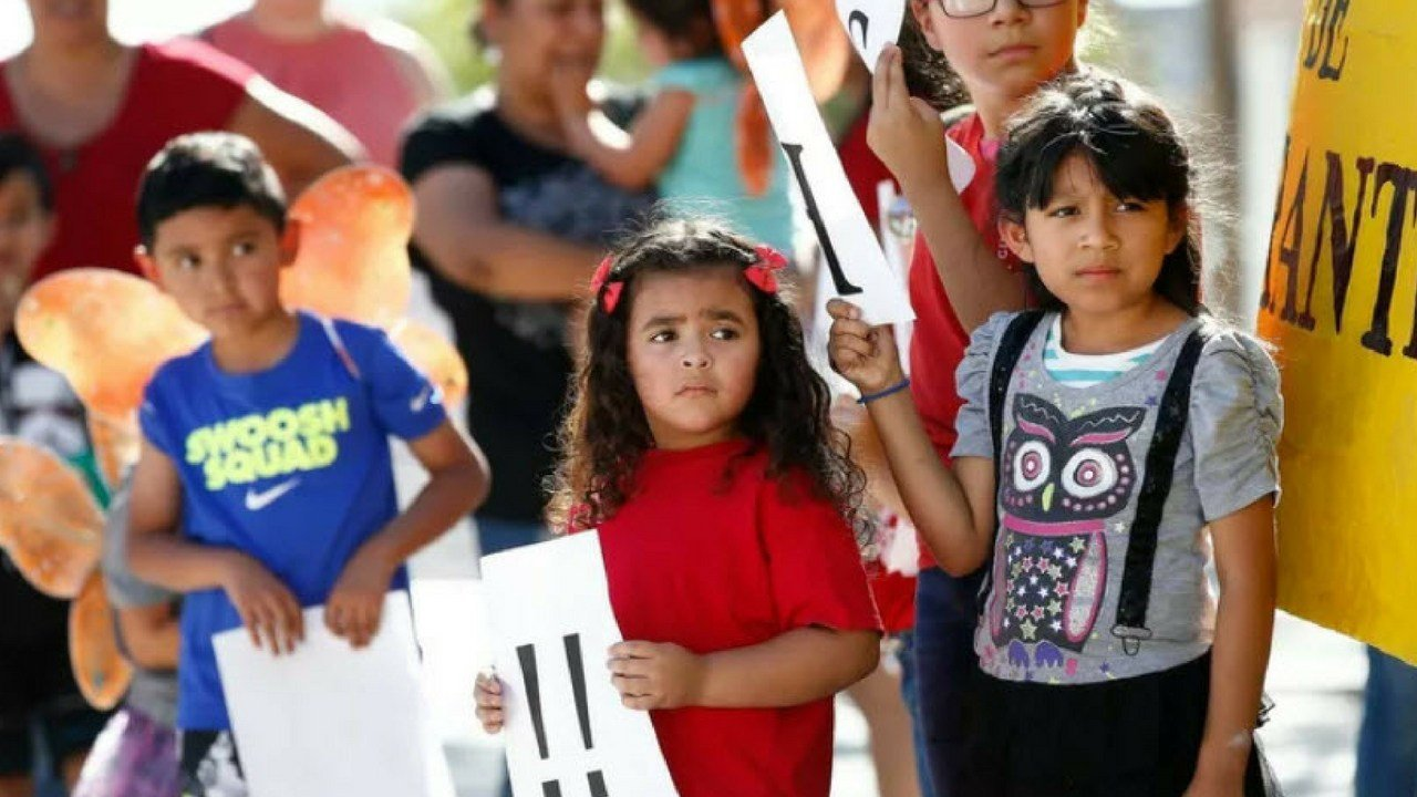 Image result for Children listen to speakers during an immigration family separation protest in Phoenix, Arizona. (AP Photo/Ross D. Franklin)