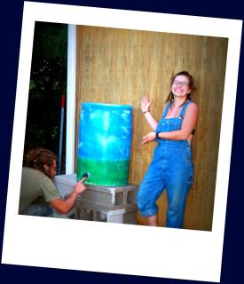 Garden Manager shows off her progess on the rain water catchment system she designed for the farm!