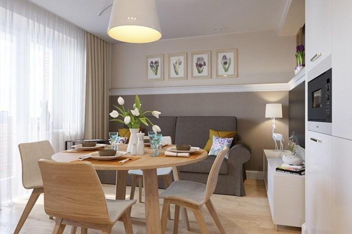 Маленькая кухня-студия с диваном напротив рабочей зоны