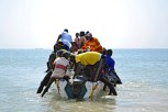 The few pirogues going to the sea are filled with unemployed neighbors and friends helping each others.