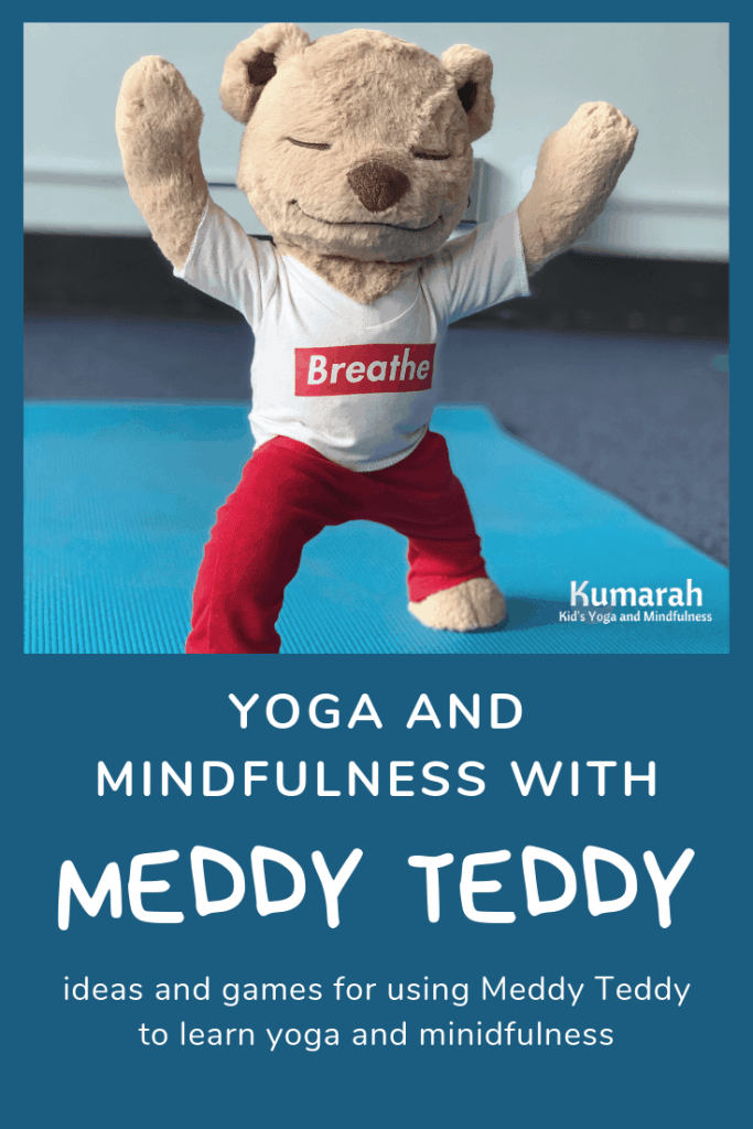 Meddy Teddy doing warrior one pose on a yoga mat in a classroom