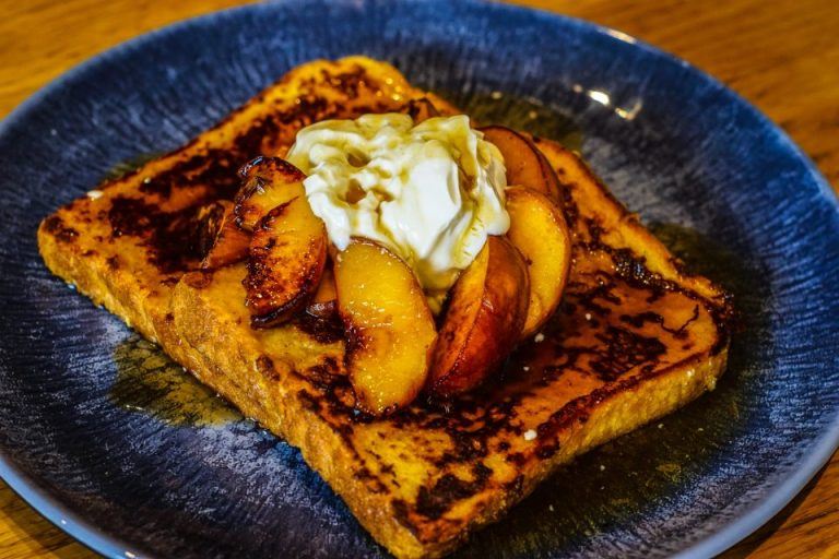 French Toast with Grilled Peaches and Spiced Rum Brown Sugar sauce