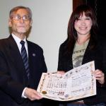 Cynthia gets her 7th Dan Tang Soo Do certificate from Grandmaster Hee Suk Choi (The most senior TSD GM in the world).