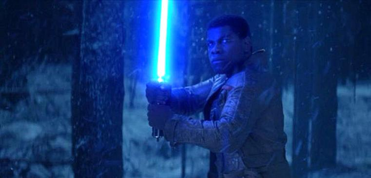 John Boyega tries his luck with a familiar weapon