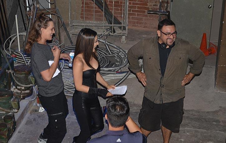 Christian having a good laugh on set